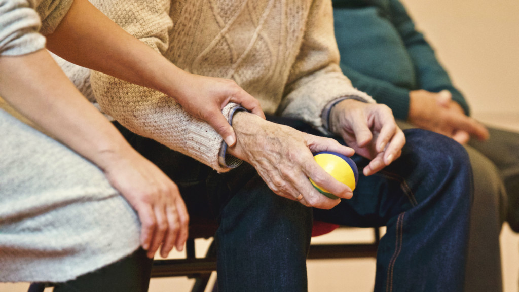 Elderly Man Holding Ball