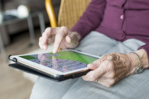 Woman Playing Solitaire on Tablet